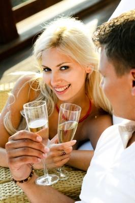 Midlife-couple-flirting-holding-champagne